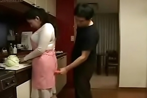 Japanese Wife and Juvenile Boy in Kitchen Fun