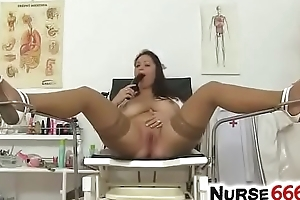 Natural busty cookie Sirale undressing her nurse uniform