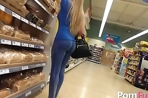 Nice blonde is being filmed in the store because that babe has a juicy ass