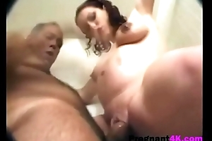Busty pregnant brunette receives screwed by and older guy-3