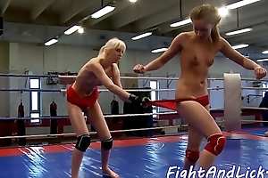 Wrestling dyke fingered in ass and pussy